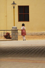 Girl_alone_outside_school