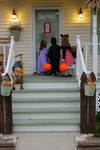 Trick_or_treat_kids_on_white_stairs_by_r